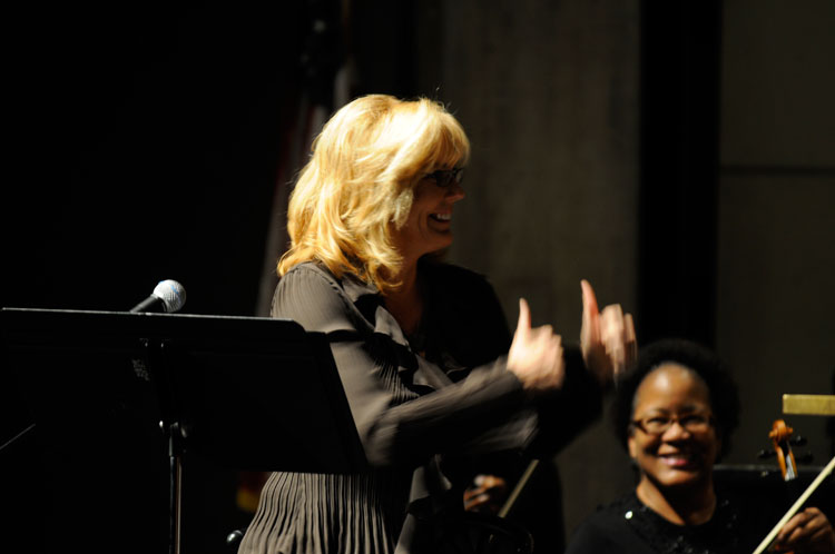 Karen Sharp congratulates the orchestra